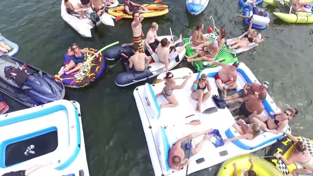 raftapalooza is an annual party where boaters are invited to 'drink, float, and meet new people'. this year over 200 boats descended on thayer beach... - vermont stock videos & royalty-free footage