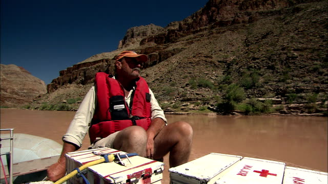 a rafter transports supplies on the colorado river in the grand canyon. - first aid kit stock videos & royalty-free footage