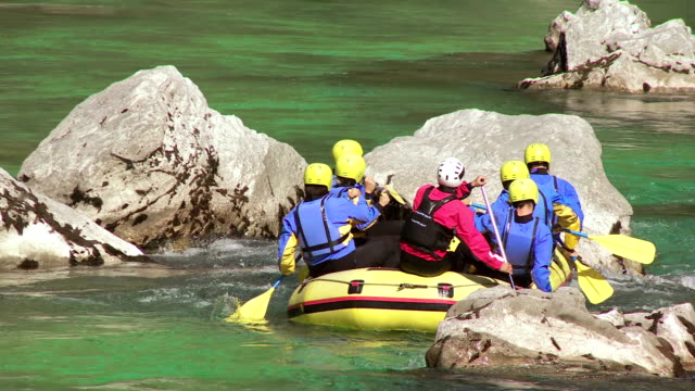 hd: rafters paddling around rocks - rafting stock videos and b-roll footage