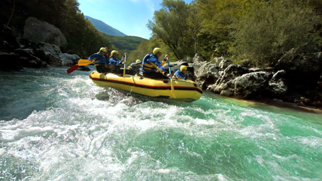 hd slow motion: rafters running the rapids - inflatable raft stock videos and b-roll footage