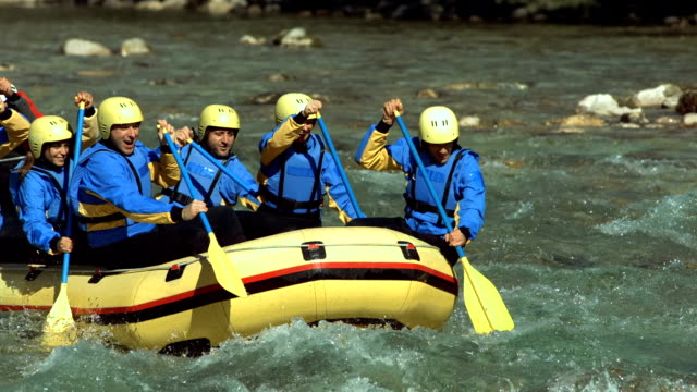 hd: rafters running the rapids - inflatable raft stock videos and b-roll footage
