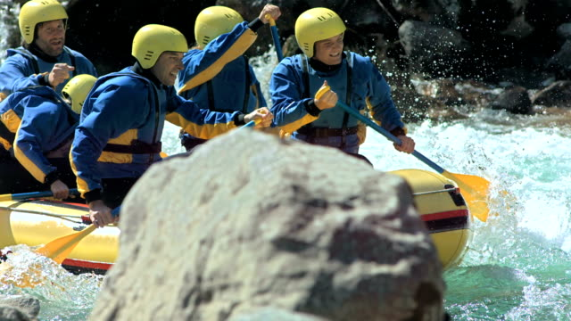 hd slow motion: rafters splashing through rapids - rafting stock videos and b-roll footage