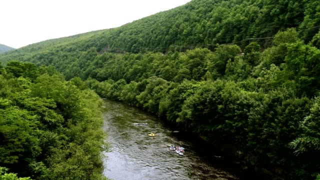 rafting at the lehigh river near by jim thorp (mauch chunk), carbon county, poconos region, pennsylvania - appalachian mountains stock videos & royalty-free footage