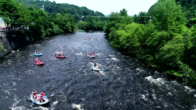 rafting at the lehigh river near by jim thorp (mauch chunk), carbon county, poconos region, pennsylvania - group of objects stock videos & royalty-free footage