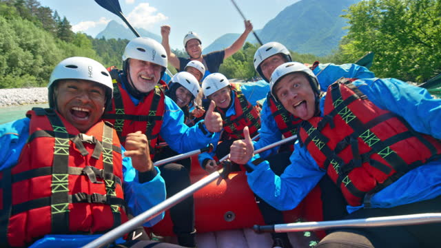 rafting team making funny faces for  the camera as they move down stream in a raft - 60 69 years stock videos & royalty-free footage