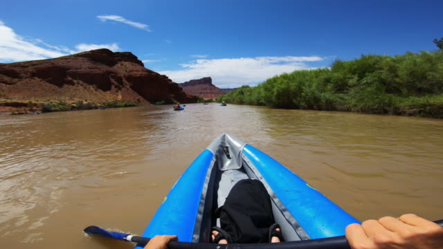 pov  rafting with kayak in colorado river, moab - moab utah stock videos & royalty-free footage