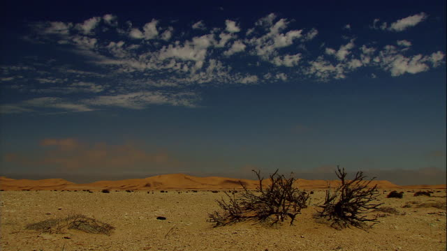 ragged clouds drift above the namib desert. - namibia stock videos & royalty-free footage