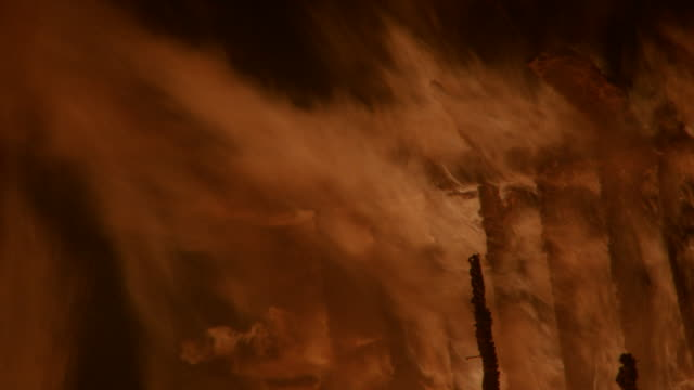 a raging fire destroys a country house at night. - inferno stock videos & royalty-free footage
