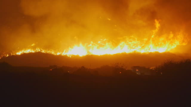 raging forest fire near the highway - california stock videos & royalty-free footage