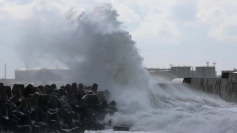 raging storm in harbor with oil tanks - high up stock videos & royalty-free footage