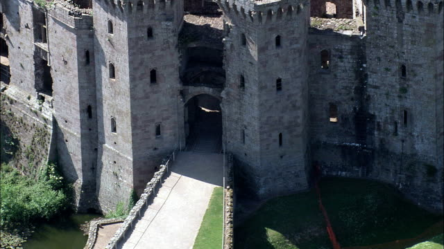 raglan castle  - aerial view - wales,  monmouthshire,  helicopter filming,  aerial video,  cineflex,  establishing shot,  united kingdom - wales stock videos & royalty-free footage