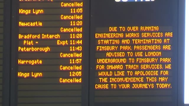 Rail cancellations and delays in and out of London over Christmas R27121403 / INT Various shots train departure boards showing cancellations Various...