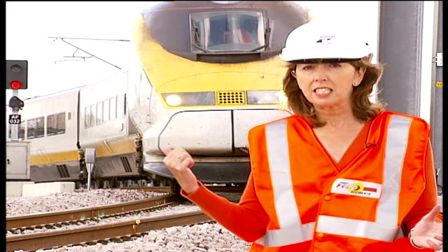channel tunnel link safety warnings reporter to camera power lines train along - la manica video stock e b–roll