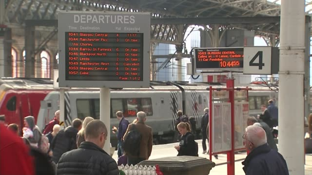 Chris Grayling orders inquiry into how rail industry is organised ENGLAND Lancashire Preston INT General view departure board on station concourse...
