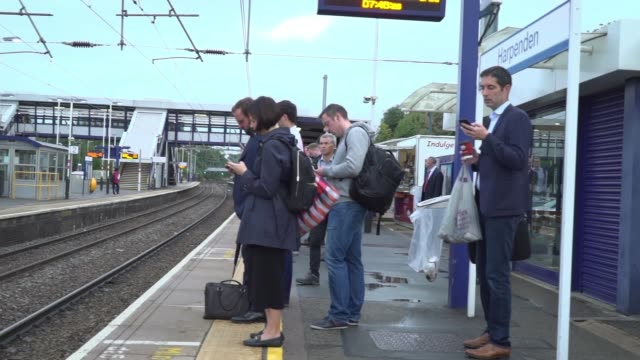 Chris Grayling orders inquiry into how rail industry is organised ENGLAND Hertfordshire Harpenden People waiting on platform at Harpenden railway...