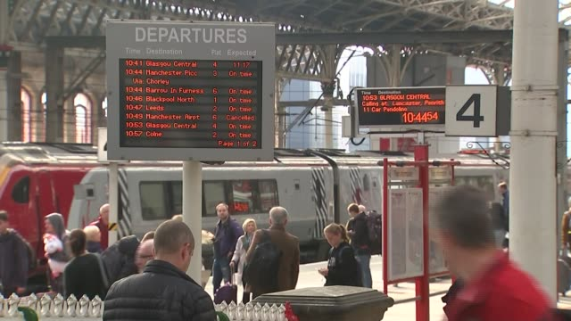 Chris Grayling orders inquiry into how rail industry is organised ENGLAND Lancashire Preston General view train station with departure board