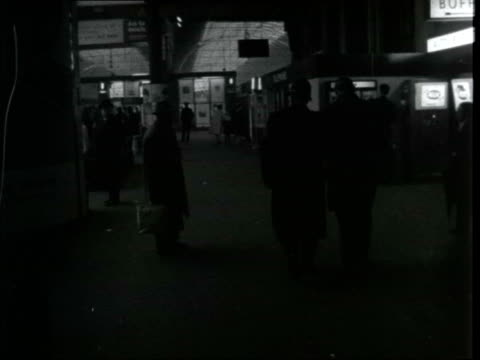 """stockvideo's en b-roll-footage met christmas mail security; england: london: paddington: ext sign """"paddington station"""" pan as gerald seymour and henry collins r-l to bv gerald seymour... - itv evening bulletin"""
