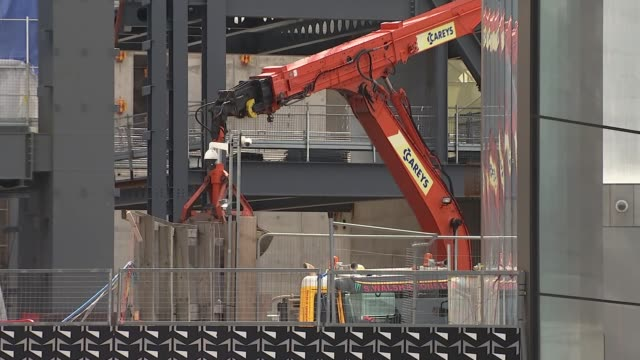 crossrail opening delayed until late 2019; uk, london, tottenham court road: digger at construction site, commuters at tube station, interviews.... - tottenham court road stock videos & royalty-free footage