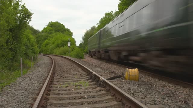 dartmoor railway line set to reopen after almost 50 years; england: devon: ext air view / aerial / drone shot engineering train along dartmoor line... - rail transportation stock videos & royalty-free footage