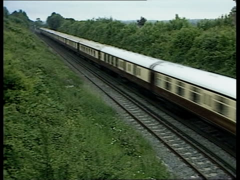 one day strike f'back train along thru countryside track view from window driver seen in cab - railway track stock videos & royalty-free footage