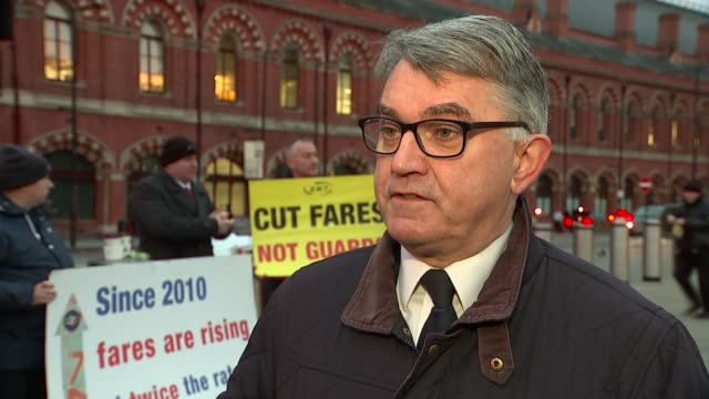 Rail fare rises / Transport Secretary Chris Grayling away in Qatar ENGLAND London King's Cross Various shots people protesting train fare rises Mick...