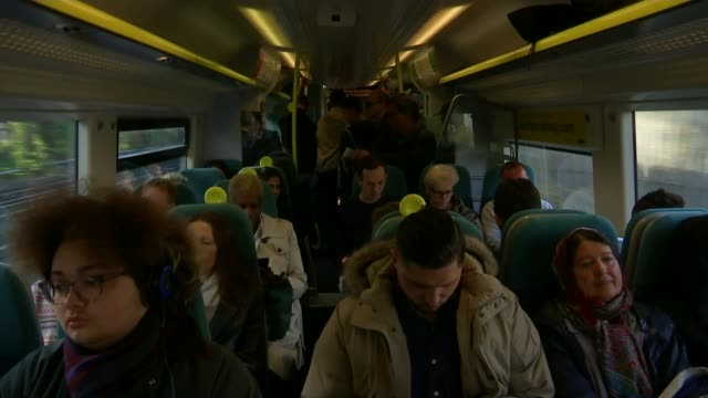 fares to rise by 23 per cent r08081611 / england london ext crowd of passengers trying to get onto busy train various shots people seated and... - cent sign stock videos & royalty-free footage