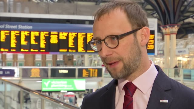 Rail fares to rise by 34 percent in new year Liverpool Street INT Paul Plummer interview SOT Train notice boards above station concourse Passengers...