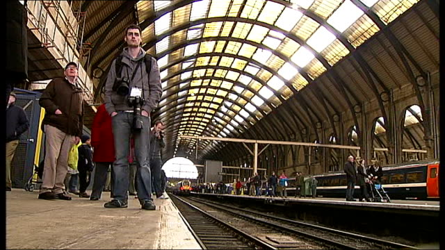 First steam passenger train for 50 years arrives at London King's Cross ENGLAND London King's Cross INT Various shots of train enthusiasts waiting on...