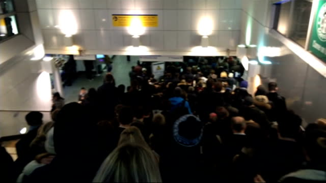 flooding at farringdon causes chaos for passengers brixton phone shots of mass of passengers trying to get down onto brixton station / sign for... - shuffling stock videos and b-roll footage