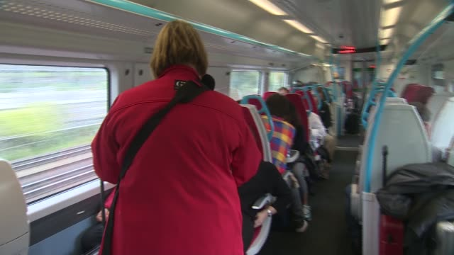 gatwick express 'onboard supervisor' further shots of gatwick express 'onboard supervisor' walking through train carriages checking passengers'... - intercom stock videos and b-roll footage
