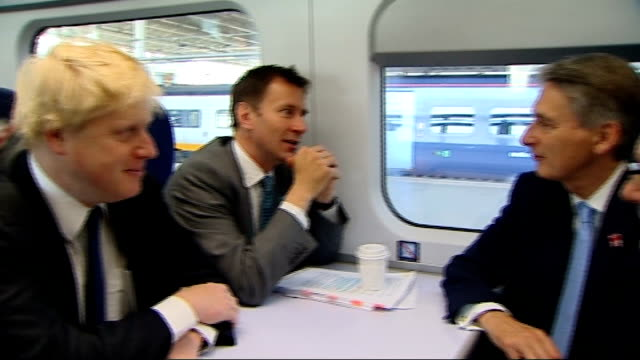 government withdraws west coast franchise tender r01061103 / st pancras international station various of boris johnson seated on javelin train during... - 政治家 ジェレミー ハント点の映像素材/bロール