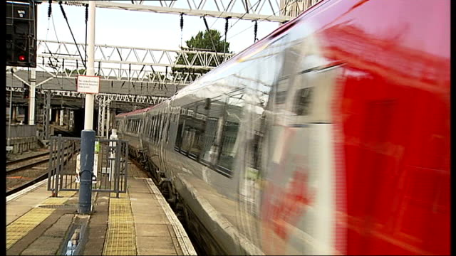 government withdraws west coast franchise tender; virgin pendolino train pulling out of station - franchising stock videos & royalty-free footage