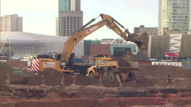 gvs birmingham new street construction site; england: midlands: birmingham: ext gvs jcb digger and truck moving earth on construction site / train... - construction site stock videos & royalty-free footage