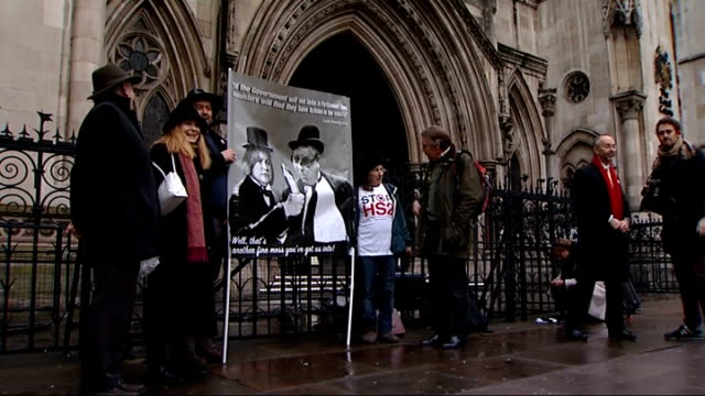 hs2 protests outside high court england london the royal courts of justice ext protester wearing 'stop hs2' tshirt / demonstrators holding banner... - patrick mcloughlin stock videos and b-roll footage