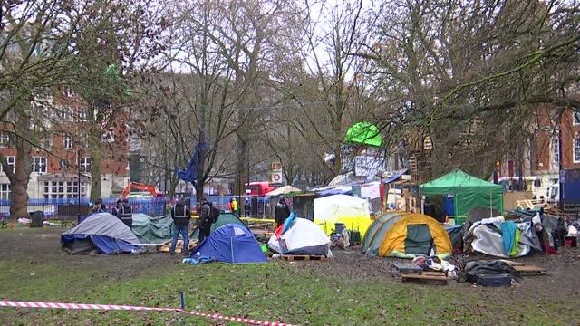 tunnel protests: bailiffs start to remove euston protesters; england: london: euston station: euston square gardens: ext various of bailiffs... - shack stock videos & royalty-free footage