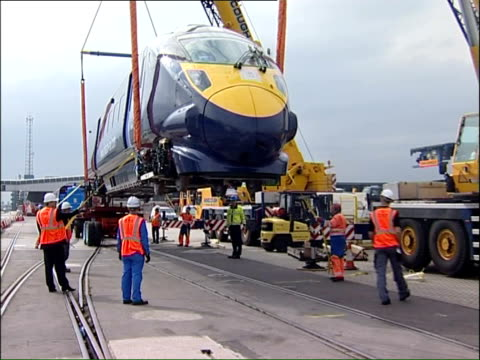 japanese bullet train arrives at southampton docks; england: hampshire: southampton docks: ext high-speed 'javelin' bullet train carriage slowly... - javelin stock videos & royalty-free footage