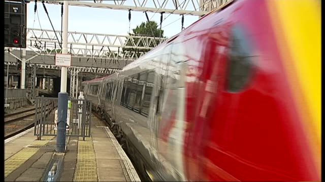 Labour Party pledge to renationlise railways T06121205 London EXT Virgin Pendolino trains at platform Virgin train leaving station Virgin train alog...