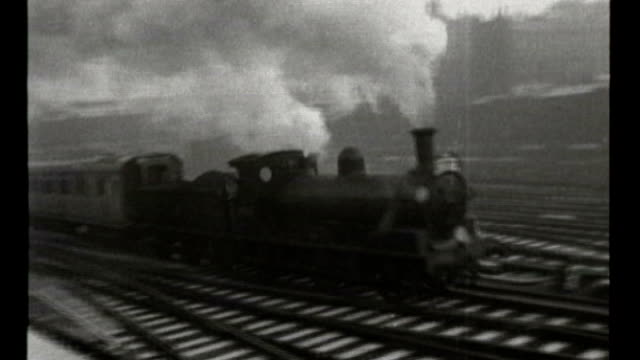 arguments continue about costs and benefits; s12080701 tx 29.1.1959 england: london: b/w footage steam train along track - locomotive stock videos & royalty-free footage