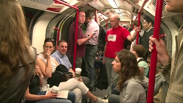 london underground installs fans at central line station; passengers on hot and busy london underground central line tube train - heat stock videos & royalty-free footage
