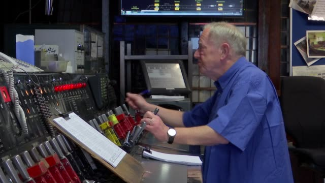 london underground: signal box; england: london: edgware road: int various of signalman working in signal box for london underground, pushing levers... - signal box stock videos & royalty-free footage