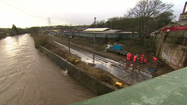 rail maintenance engineers work on flooded train lines due to storm ciara - railway track stock videos & royalty-free footage