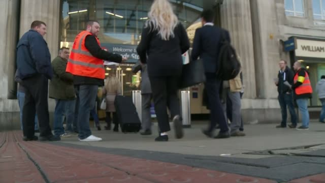 Merseyrail Northern Rail and Southern Rail staff on strike Yorkshire Leeds EXT Low angle shot commuters along towards Leeds station past picket line...