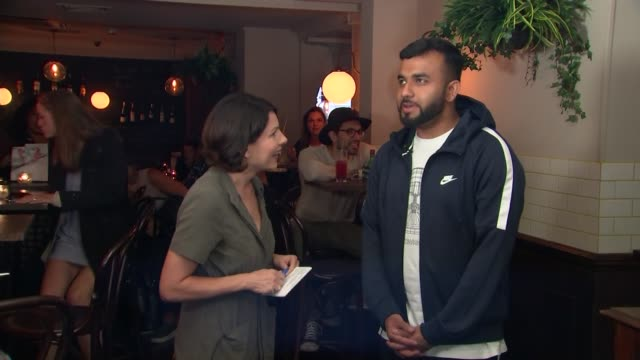 night tube launch: poem by hussain manawer; england: london: soho: int hussain manawer live interview sot - literatur stock-videos und b-roll-filmmaterial