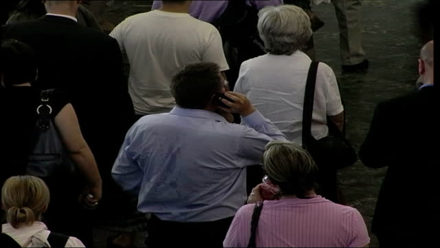 london euston int general views of train passengers waiting around in euston train station concourse during heat wave man with sweat on his shirt... - sweat stock videos & royalty-free footage