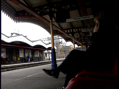 more fraud allegations ms female passenger towards up stairs pan lr as onto british rail platform ms british rail 'walthamstow central' sign on wall... - franchising stock-videos und b-roll-filmmaterial