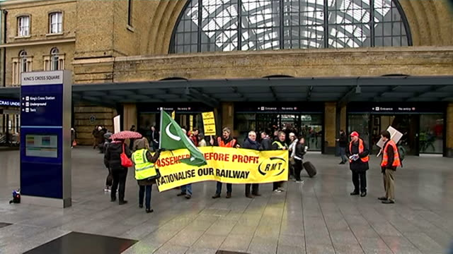 protest against privatisation of east coat main line franchise; england: london: king's cross station: ext rmt union members holding banner... - franchising stock videos & royalty-free footage
