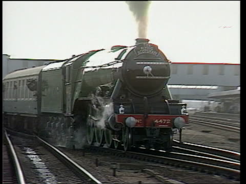 retired train driver bill bridle drives 'the flying scotsman' again to mark his 81st birthday england cambridgeshire peterborough peterborough... - family with two children stock videos & royalty-free footage