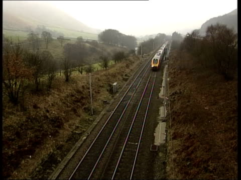 runaway wagon accident previous incident itv england cumbria tebay virgin trains train along west coast mainline and passing under camera position - itv late news stock-videos und b-roll-filmmaterial