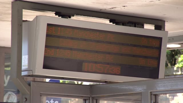 Second day of travel disruption after biggest train timetable change across Britain for decades Greater Manchester Train departure board High angle...