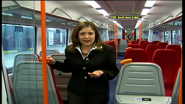 south west trains begins new ten-year franchise; int train reporter to camera int stewart palmer interview sot - franchising stock videos & royalty-free footage